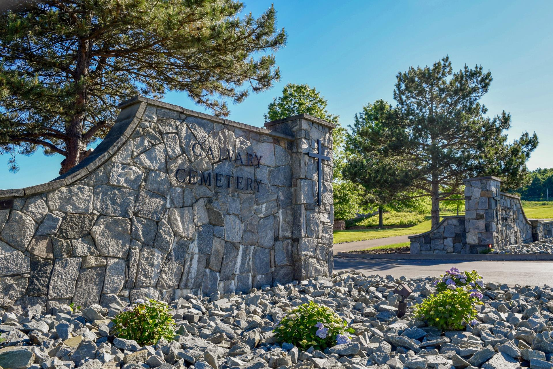 Stone walls at entrance to Calvary Cemetery