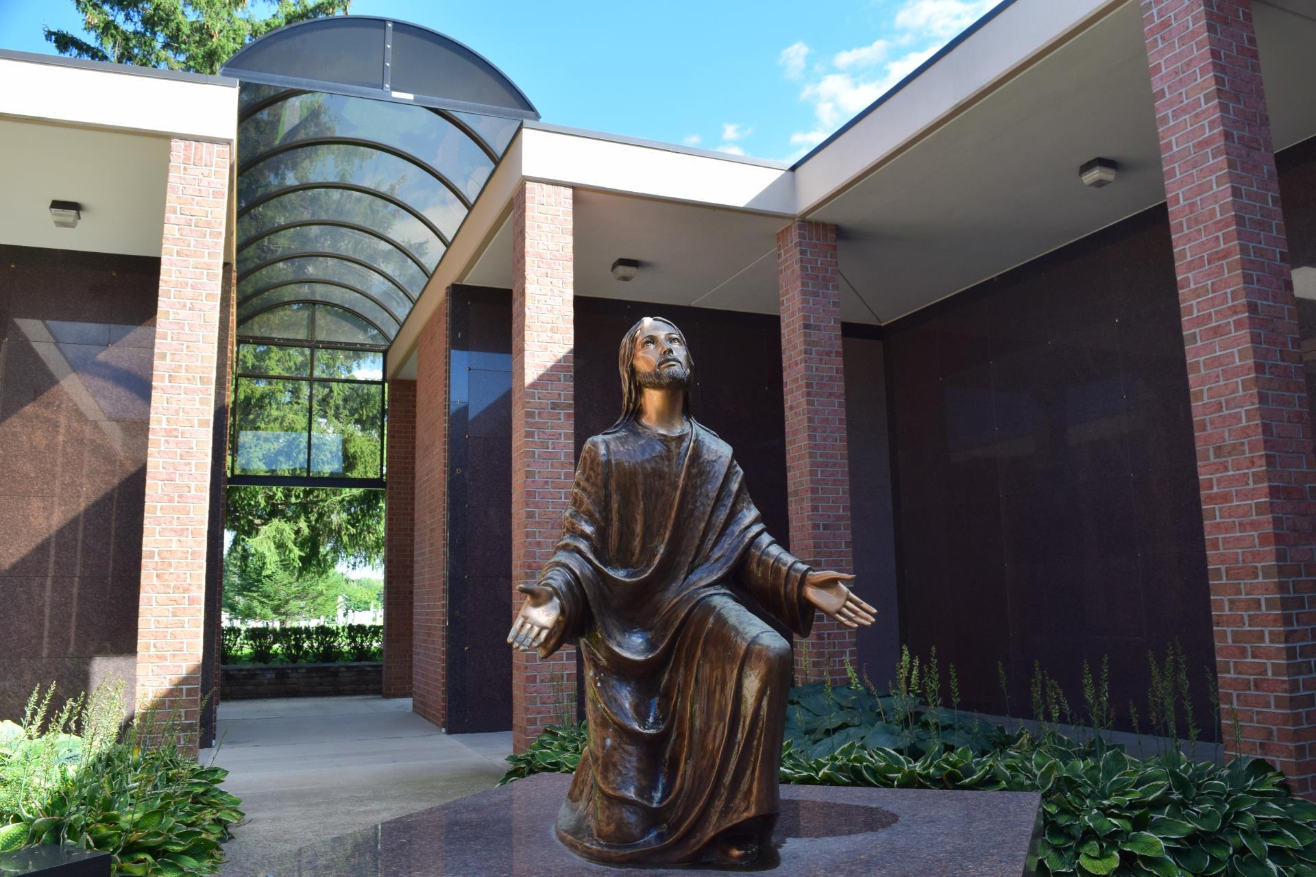 Bronze monument of Christ kneeling